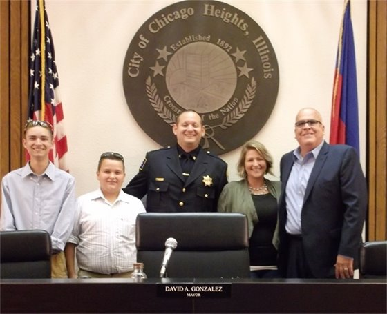 Sgt. Bakowski with Mayor Gonzalez and Family